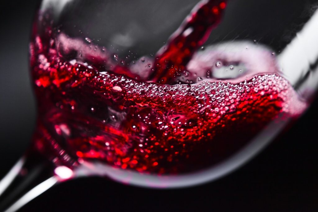 RED WINE Red wine in wineglass on black background Uploaded by: SINASAC